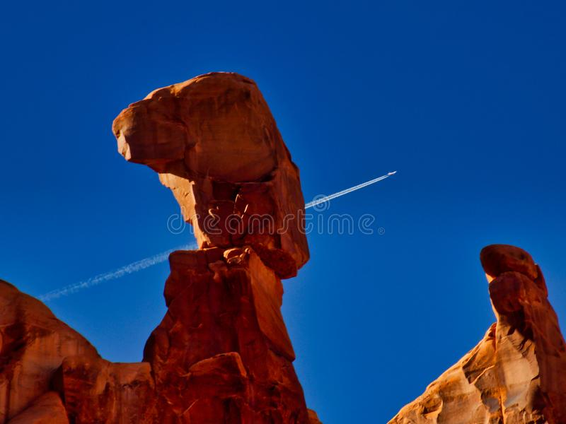 Jet Over Arches Park Avenue. Park Avenue Trail. Arches National Park in Utah offers spectacular views of mountains and rock formations. Beautiful in Winter. Near royalty free stock image