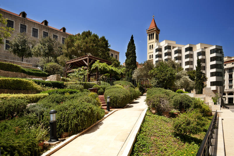 Park in Beirut downtown. Park near old roman thermes ruin vith view to St.Louis bell tower in Beirut downtown, Lebanon stock photo
