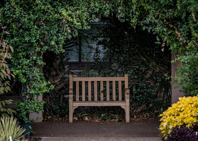 Park Bench in Alcove. In outdoor garden royalty free stock photos