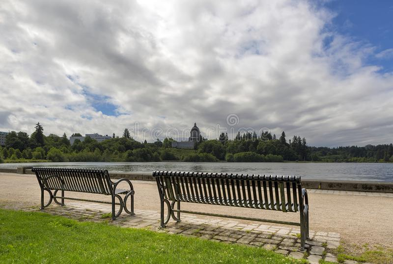 Park Bench along Capitol Lake in Olympia Washington. Park bench along scenic Capitol Lake in Olympia Washington State on a cloudy day royalty free stock images