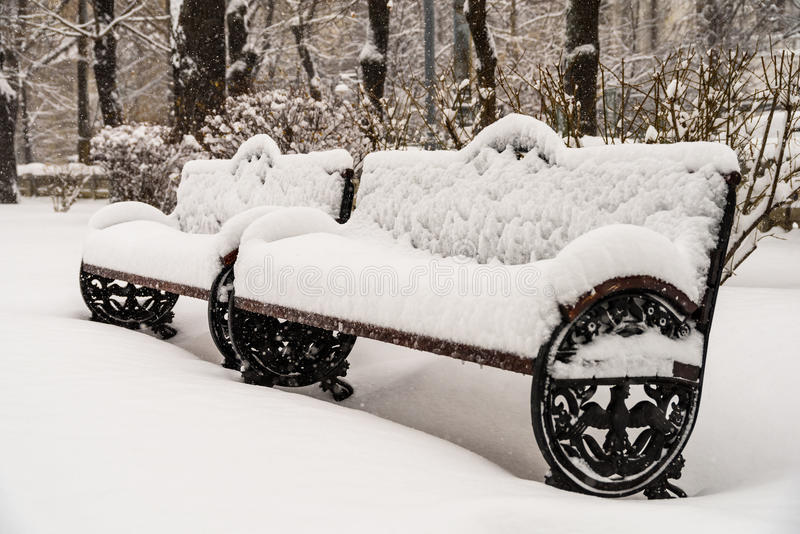 Park Bench Covered With Fresh White Snow stock photography