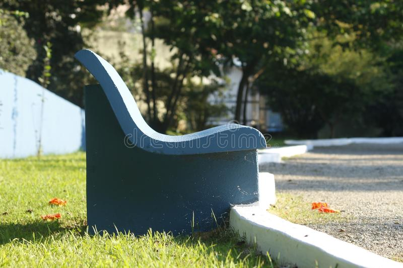 Park bench made of cement. Blue park bench made of cement in parque chico mendes, sao caetano do sul royalty free stock photo