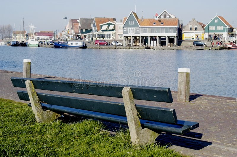 Park bench overlooking Volendam Harbour, Holland stock photos