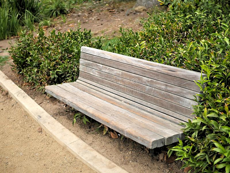 Park bench in a Santa Barbara, California botanical garden with paths and plants.  stock photo