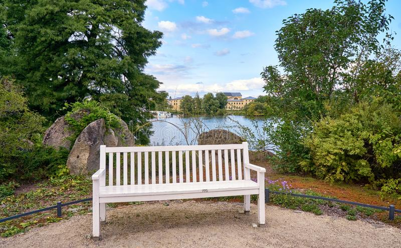 Park bench with the Schwerin lake in the background stock image
