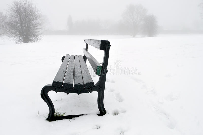 Park bench in the snow stock photography