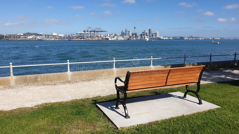 A park bench view of Auckland city stock photos