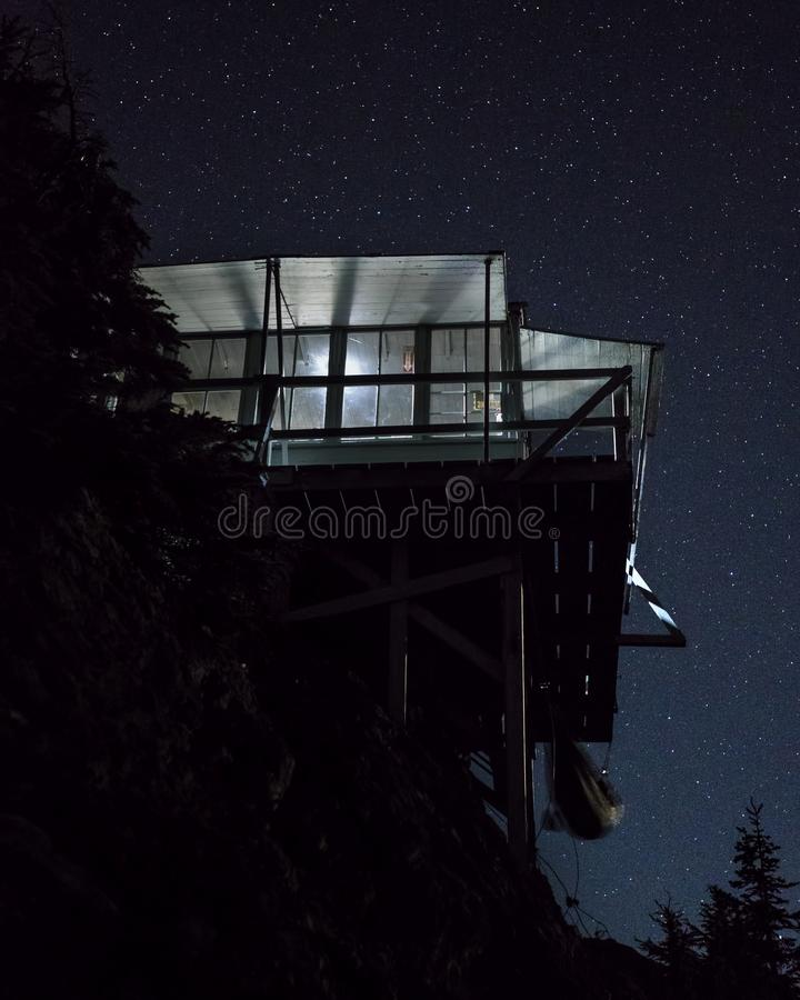 Stars Over Steep Fire Lookout Station. The Park Butte Fire Lookout Station is Carefully Perched under Stars on a Perfectly Clear Winter Evening royalty free stock image