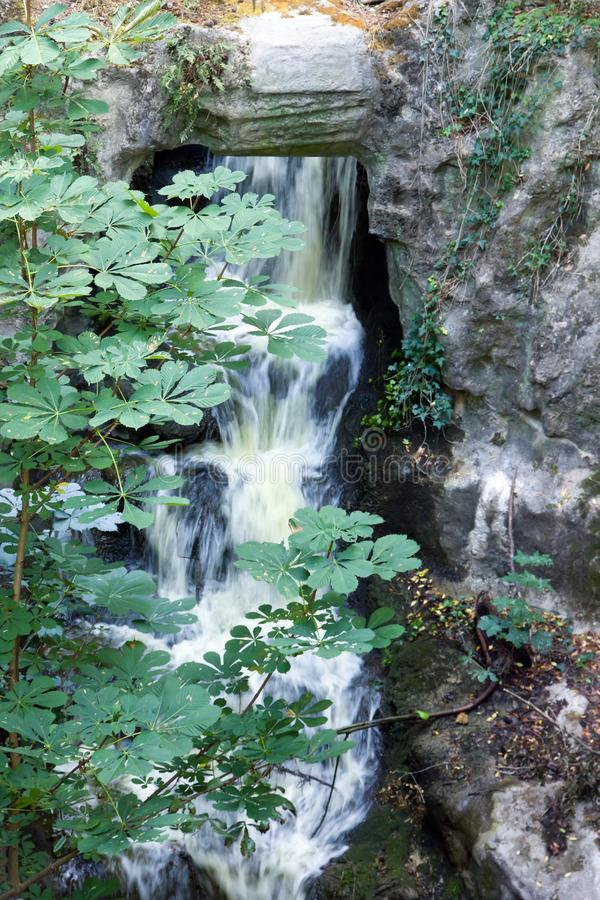 Park of Buttes-Chaumont Paris France. Vegetation and freshness, the waterfall park of Buttes-Chaumont Paris France stock photography