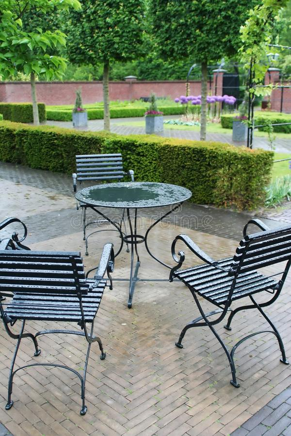 Park cafe in rain royalty free stock image