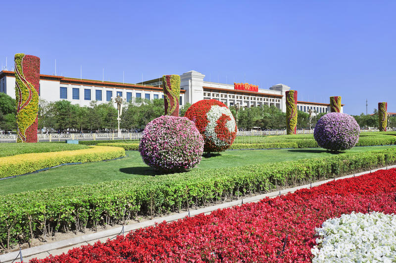 Park with colorful flowers on Tiananmen square with National Museum, Beijing, China. Park with colorful flowers on Tiananmen square with National Museum on the stock photo