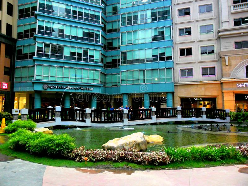 Park in Eastwood City. Pond in a park in eastwood city in libis, quezon city, philippines stock photos