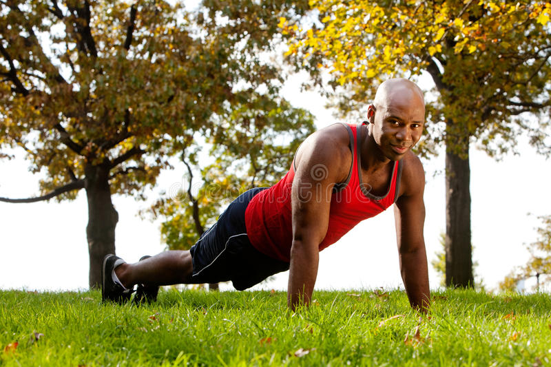 Park Exercise. An african american doing exercises in the park stock photography