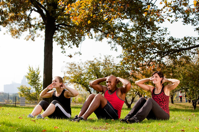 Park Exercise. A group of people doing exercises in the park royalty free stock photography