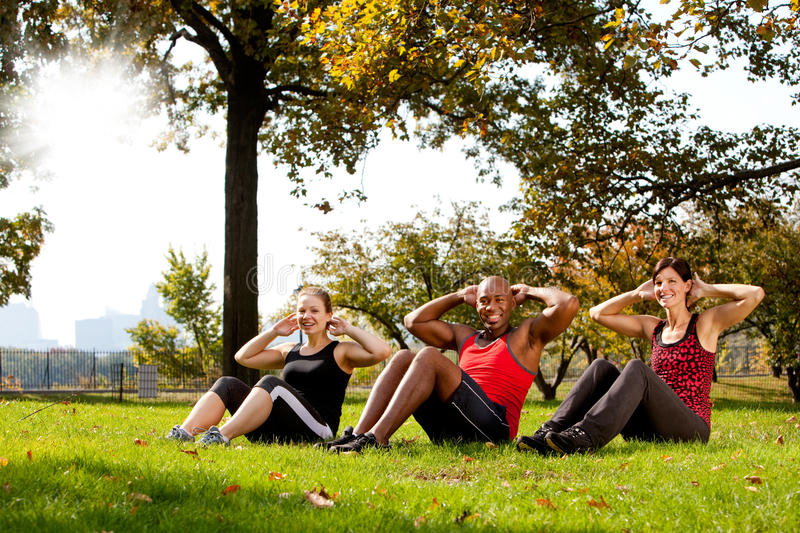 Park Exercise. A group of people doing exercises in the park royalty free stock photos
