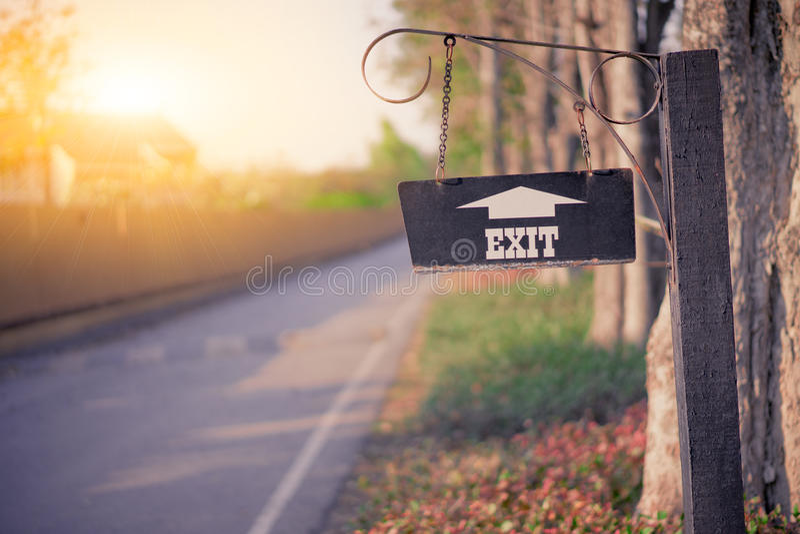 Park exit sign in the evening sun. Park exit sign in the evening sunshine stock images