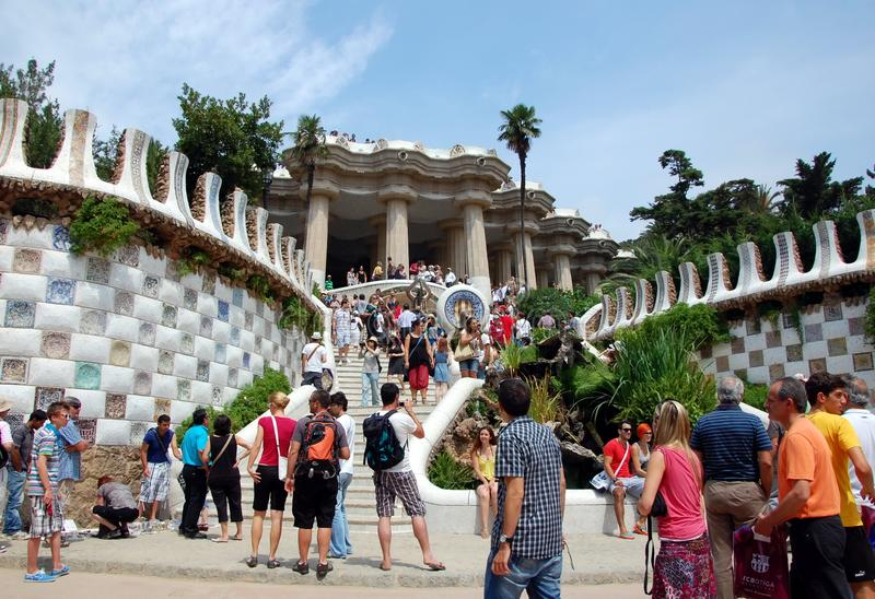 Park Guell in Barcelona, Spain. BARCELONA, SPAIN - JULY 3, 2011 - Crowds of tourists in Park Guell in Barcelona, Spain, one of the major examples of the work royalty free stock image