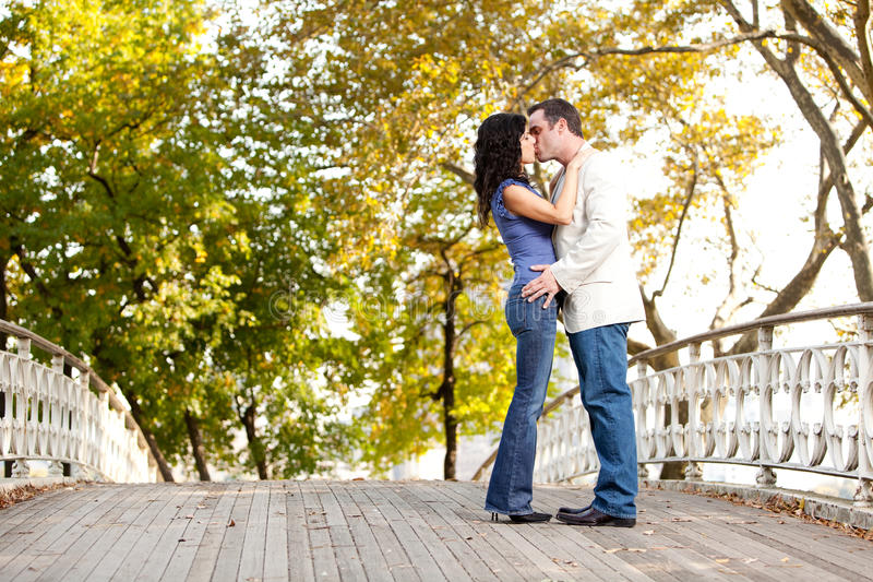 Park Kiss. A couple kissing while walking in the park stock images