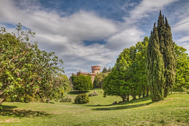 Park with medieval castle in Volterra, Tuscany, Italy stock photography