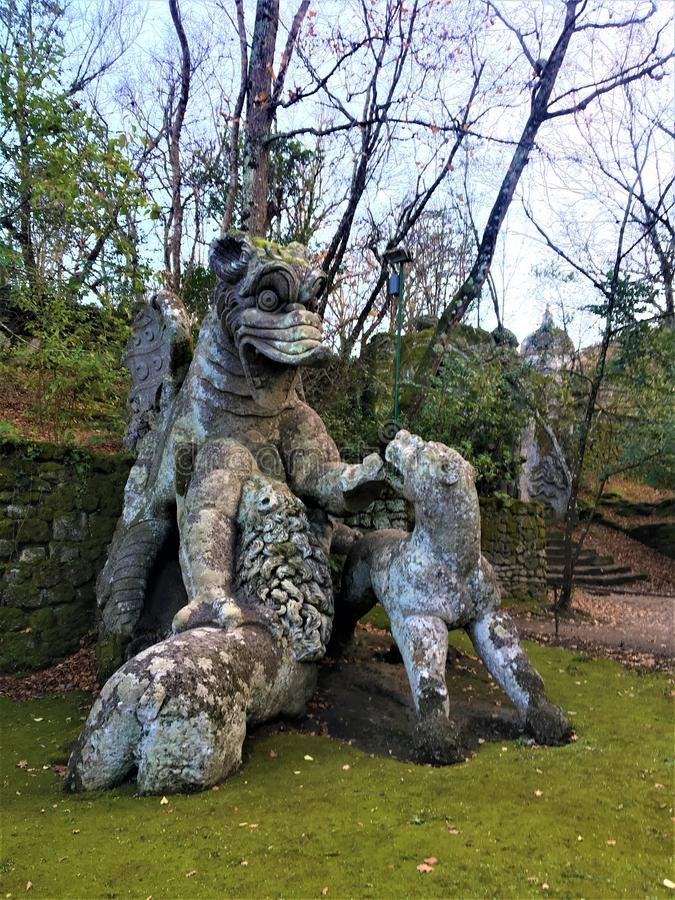 Park of the Monsters, Sacred Grove, Garden of Bomarzo. Dragon with lions, alchemy stock image