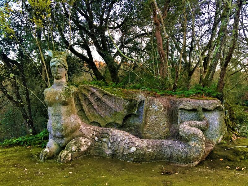 Park of the Monsters, Sacred Grove, Garden of Bomarzo. Harpy with bat wings. Park of the Monsters, Sacred Grove, Garden of Bomarzo, a Manieristic monumental royalty free stock photos