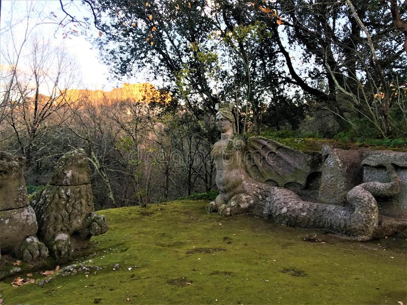 Park of the Monsters, Sacred Grove, Garden of Bomarzo. Lions and harpy, alchemy royalty free stock photography