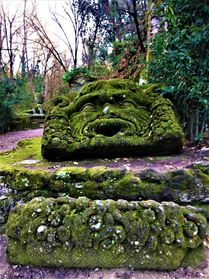 Park of the Monsters, Sacred Grove, Garden of Bomarzo. Mask of Jupiter Ammon. Park of the Monsters, Sacred Grove, Garden of Bomarzo, a Manieristic monumental stock photography