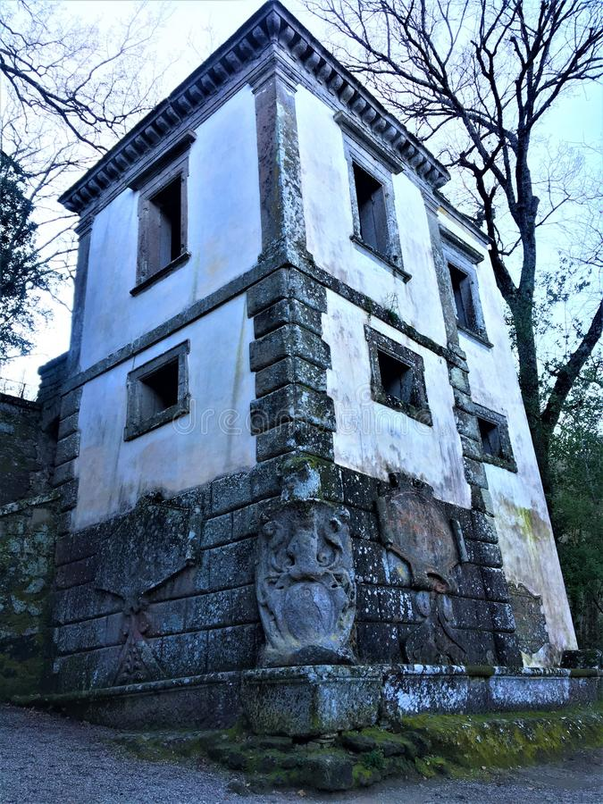 Park of the Monsters, Sacred Grove, Garden of Bomarzo. Leaning house and alchemy. Park of the Monsters, Sacred Grove, Garden of Bomarzo, a Manieristic monumental royalty free stock image