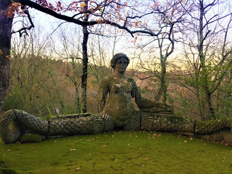 Park of Monsters, Sacred Grove, Garden of Bomarzo. Mermaid and nature stock image