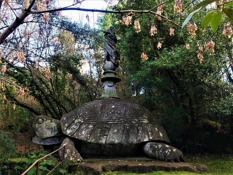 Park of Monsters, Sacred Grove, Garden of Bomarzo. A turtle with a winged woman on its back. Park of Monsters, Sacred Grove, Garden of Bomarzo, a Manieristic royalty free stock image