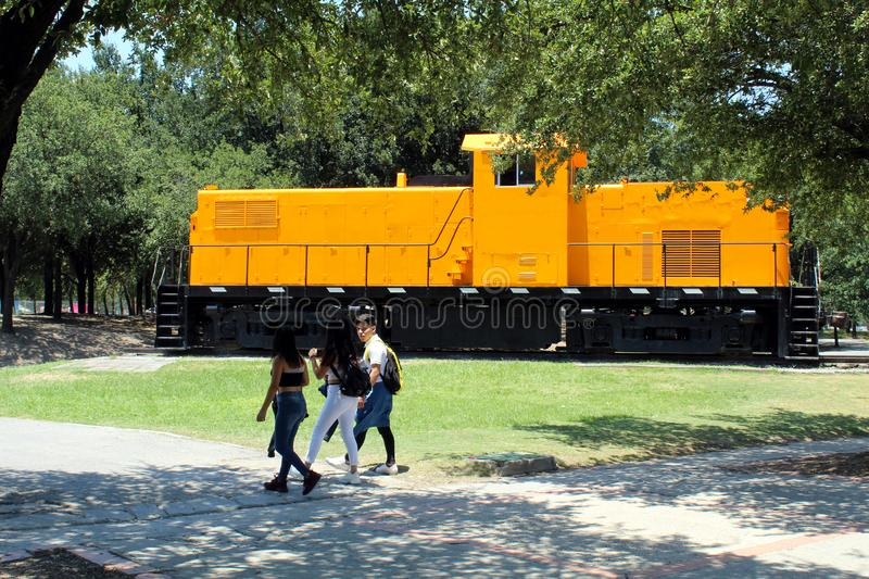 Park with old train and people enjoying royalty free stock images