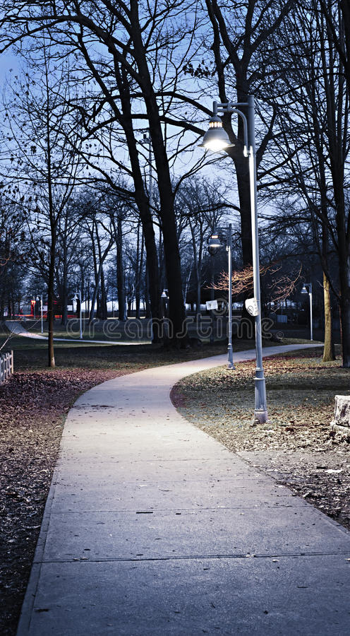 Download Park path at dusk stock photo. Image of night, lamppost - 13876134