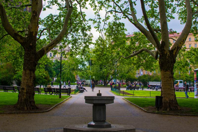 Park in Peace Square náměstí Míru with a fountain and trees, in Vinohrady, Prague, Czech Republic.  stock image