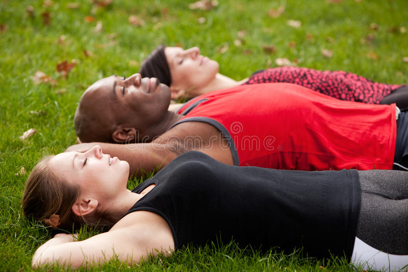Park Relax. A group of people relaxing in a park after exercise royalty free stock images