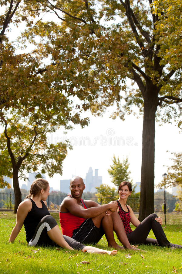 Park Relax. A group of people relaxing in the park after exercise royalty free stock photo