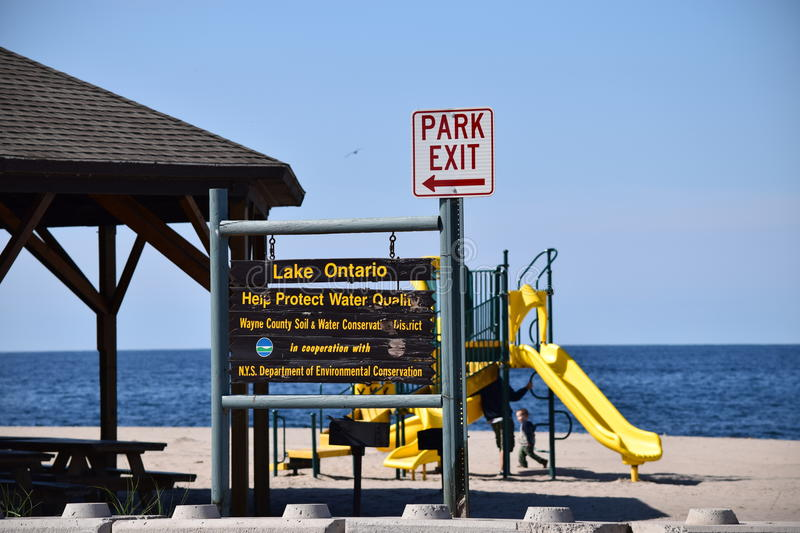 Keep it Clean and Park exit Signs at Sodus Point Bay. Keep it Clean and Park Exit Signs seen at Sodus Point Bay beach, picnic, and play area stock photo