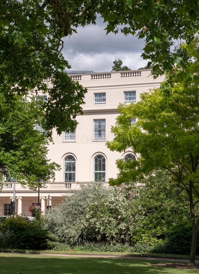 Park Square and Park Cresent gardens overlooking the Nash Terrace townhouses built in neoclassical style at Regent`s Park, London. Park Square and Park Cresent royalty free stock photos