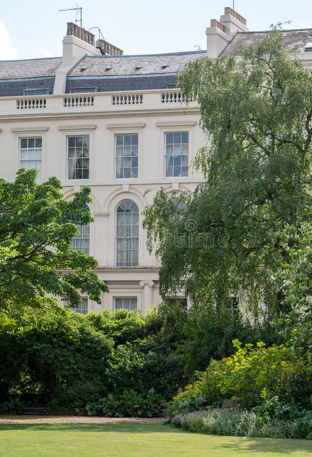 Park Square and Park Cresent gardens overlooking the Nash Terrace townhouses built in neoclassical style at Regent`s Park, London. Park Square and Park Cresent stock photo
