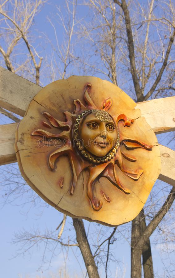 Wooden Sun mask stock photo