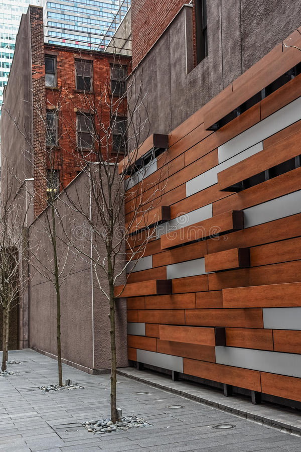 Park Wall. A Mid-Town Manhattan park with a wood paneled wall and bare Winter trees stock photos