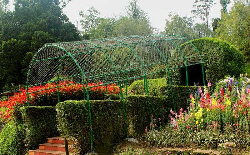 Park way and arch in the bryant park. Park way and arch in the bryant park, kodaikanal. Kodaikanal is a city near Palani in the hills of the Dindigul district stock photo