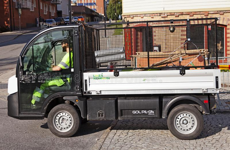 Park workers in the municipality drive around in their work truck for the next assignment stock photography