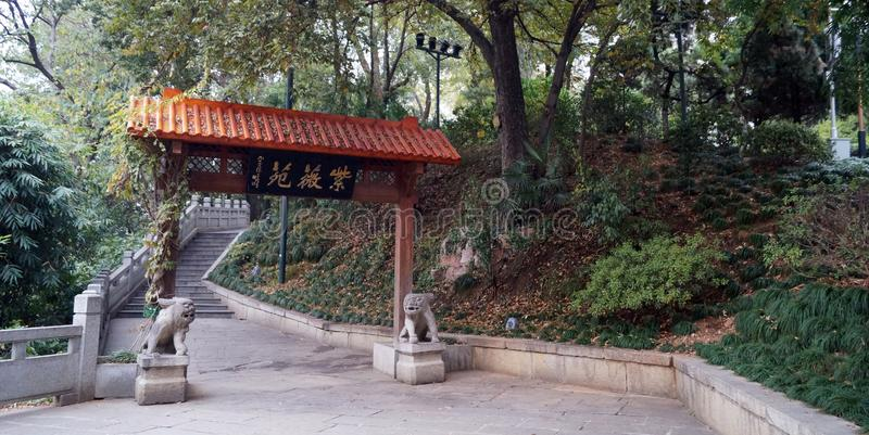 Park in Wuhan China. Decoration in a park in the centre of Wuhan china, wood arc with two stone feline figures at the sides in the lower side of a stairs stock photos