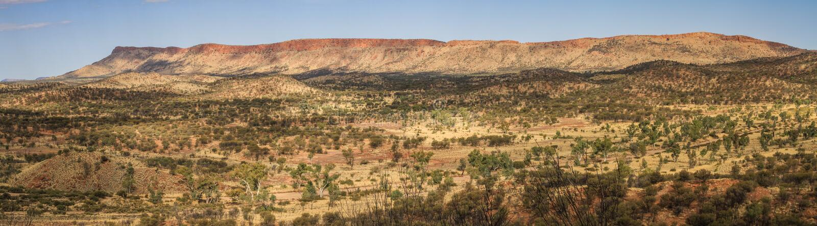 Panoramic view of the west McDonnell range fron Cassia Hill, Northern Territory, Australia. Park your car in the parking area and spend an hour doing very, very royalty free stock image