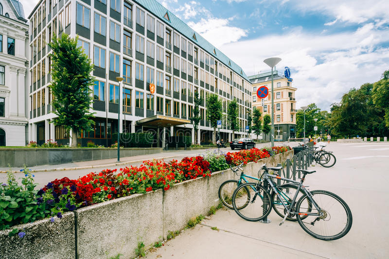 Parked Bicycle On Sidewalk near The Ministry of. OSLO, NORWAY - JULY 31, 2014: Parked Bicycle On Sidewalk near The Ministry of Foreign Affairs of Norway royalty free stock photo