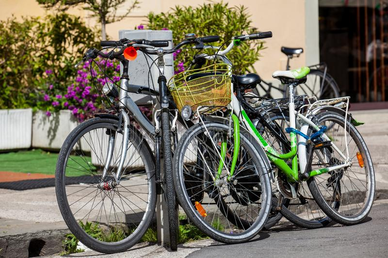 Parked bicycles on the streets of Pisa. Parked bicycles at the beautiful streets of Pisa stock images