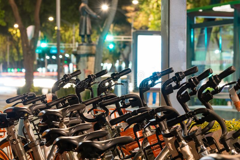 Parked bicycles in the street. Night scene stock photos