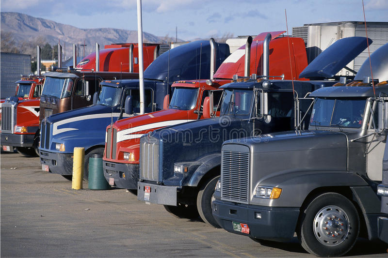 Download Parked Big Rig Trucks editorial stock image. Image of commerce - 23147684