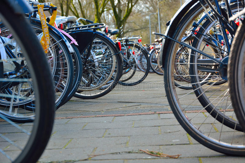 Parked bikes. Wheels of parked bikes in a street in Eindhoven, the Netherlands stock photography