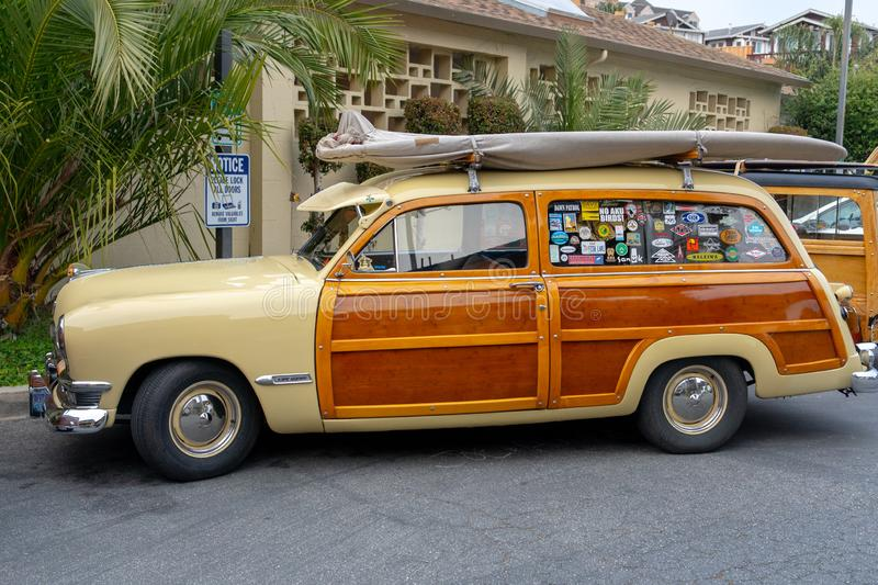 Parked Brown And Beige Station Wagon With Surfboard On The Roof Free Public Domain Cc0 Image